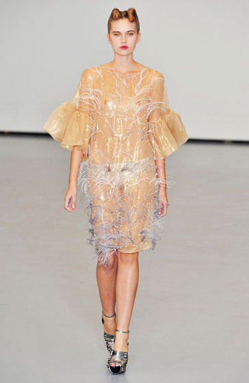 Small feathery decorations covered a shimmery yellow number, making this a half-chicken, half-nude dress.