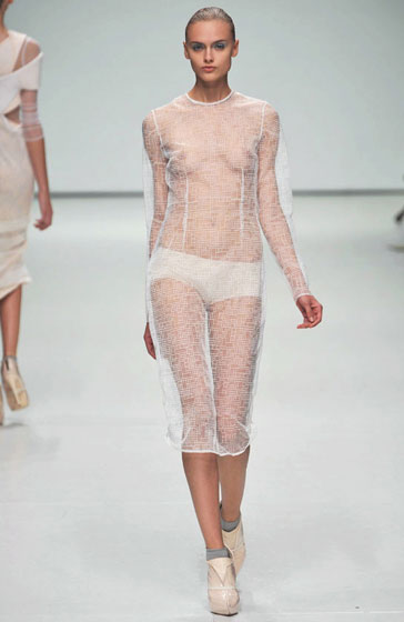We're confused by Louise Goldin's netted dress. The fact that it's long-sleeved and below-the-knee implies cover-up, but we see <em>everything</em>.