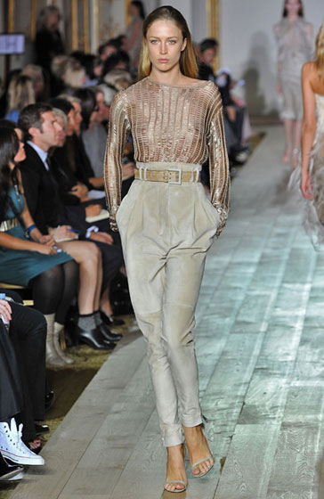 Raquel Zimmermann wears a sheer sweater from Julien Macdonald's collection.