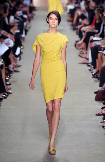 The draping and bright color (finally, color!) caught our eye. Simple, classic, and so wearable.