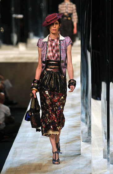 Marc Jacobs always pushes fashion forward. Next season, expect layers, plaids, obilike belts, chunky accessories, and flattened hats to be on everyone else's runway.