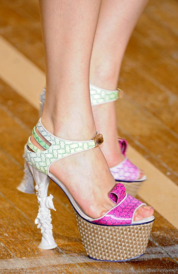 These basket-weave platforms have little birds on the heels!