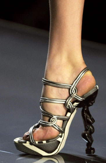 The heels at Dior were little statues with lovely lady humps. And they were so high models may as well have worn point shoes.