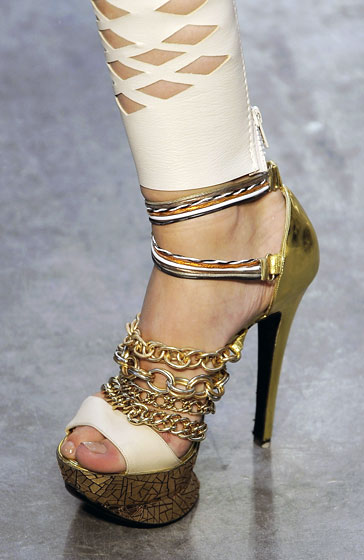 Abbey Lee took a spill in the platform stilettos at Rodarte.