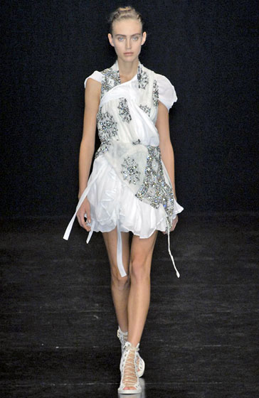 Ann Demeulemeester's ruffle-filled collection had some pretty dresses like this white embellished number.