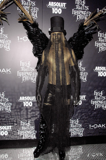 Marc Bouwer's dark-angel costume is legitimately scary. How does one drink with all that netting?