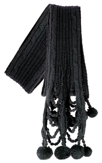 Cutouts and dangling poms add eye-catching details to a standard cold-weather staple. <em>Gothic Pom Scarf, $36</em>.