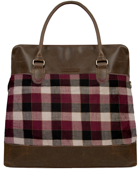 The vinyl Ivy League bag is large enough to tote around your work gear and a stash of magazines, while flashing an understated dose of autumnal plaid. <em>Pink Studios Ivy League Weekender, $66</em>.