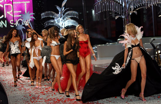 The rose petals on the runway were synthetic and the palm trees were made of crystals, but the models' enthusiasm? As genuine as Miami is sunny.