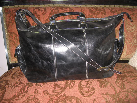Cordovan bag in black, leather lined with antique brass hardware, $895.