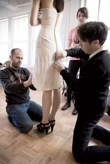 Ruffian designers Brian Wolk and Claude Morais in a fitting.