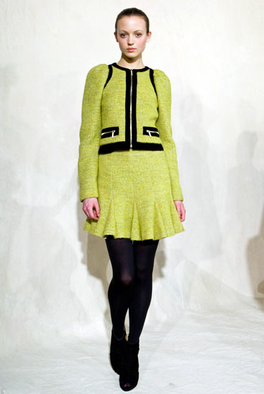 The skirt suit is traditional. But a neon skirt suit ... upgrade?