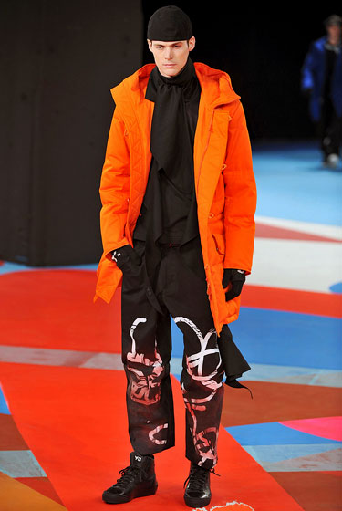 Let's hear it for the boys! Neon is for men, too; here's Yohji Yamamoto's carrot-colored jacket at Y-3.