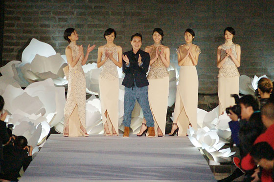 Phillip Lim poses with models wearing the five looks he created for the event.