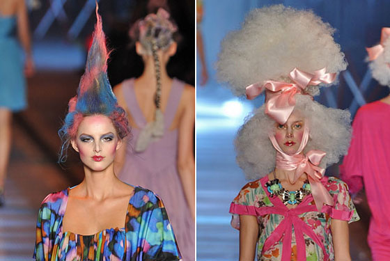 John Galliano alternated between colorful, gelled hair sculptures and white wigs with bows.