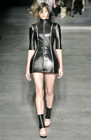 This Alexander McQueen sexy minidress hugs your curves.