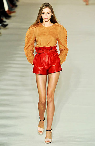 Chloe played with colors and cuts: high-waisted, red leather short shorts.