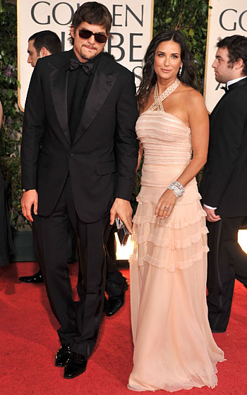 Ashton Kutcher with Demi Moore in Christian Dior.