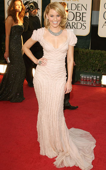 Elizabeth Banks in J. Mendel, a hair clip by Fred Leighton, and jewelry by Lorraine Schwartz.