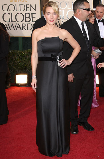 Kate Winslet in Yves Saint Laurent, jewelry by Chopard, and makeup by Jillian Dempsey.