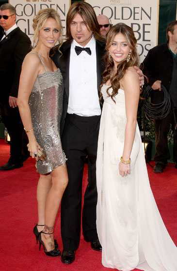 Leticia Cyrus in vintage Max Azria, Billy Ray Cyrus, and Miley Cyrus in Marchesa and makeup by Mark.