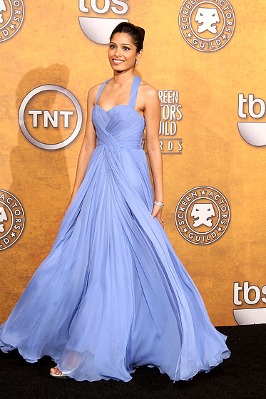 This cornflower-blue Marchesa number is, simply put, sensational: pretty without being twee, and youthful without making us gag. We want to put it on and twirl for a while.