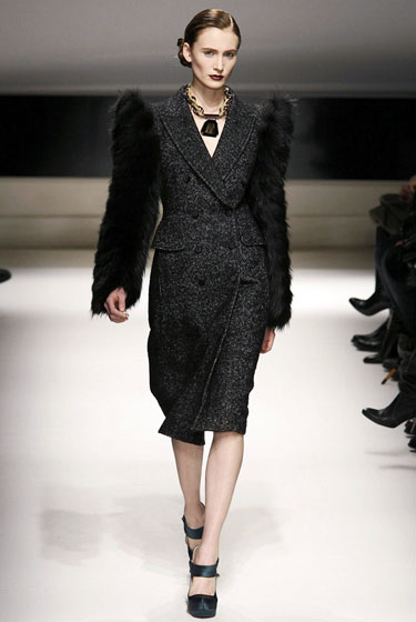 "The designers of <a href=""http://nymag.com/fashion/fashionshows/2009/fall/main/europe/womenrunway/aquilanoerimondi/"">Aquilano e Rimondi</a> updated a simple tweed coat with thick, black, furry arms."