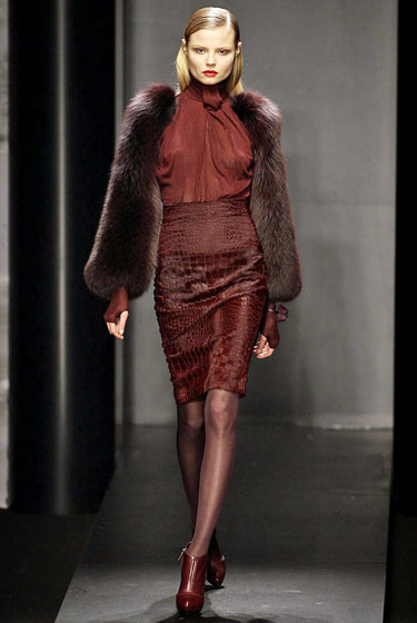 "A rust-colored blouse turns into outerwear simply by adding maroon fur sleeves at <a href=""http://nymag.com/fashion/fashionshows/2009/fall/main/europe/womenrunway/salvatoreferragamo/"">Ferragamo</a>."