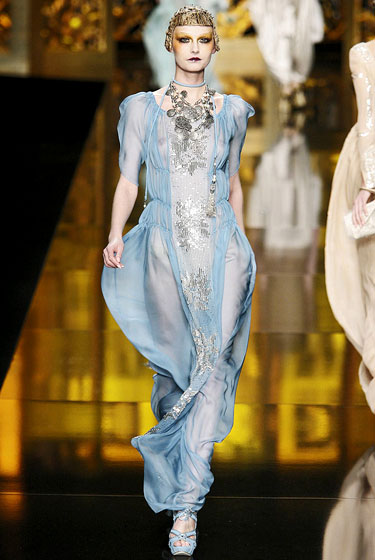 Silver embroidery accents a sheer diaphanous gown that is pure John Galliano.