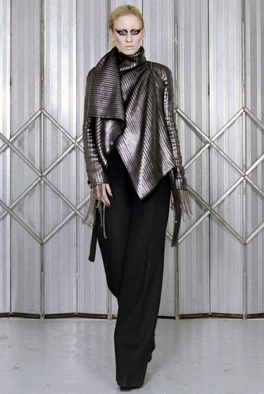 "<a href=""http://nymag.com/fashion/fashionshows/2009/fall/main/europe/womenrunway/garethpugh/"">Gareth Pugh</a>'s shiny metallic ribbed jacket with dangling wrist chains is beautifully draped and surprisingly elegant and wearable."