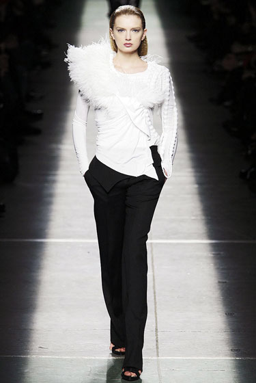 "Black and white never looked so good! <a href=""http://nymag.com/fashion/fashionshows/2009/fall/main/europe/womenrunway/givenchy/"">Givenchy</a>'s ethereal white top glides over simple black pants."