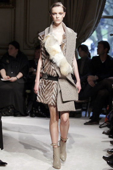 "The coat gets deconstructed at <a href=""http://nymag.com/fashion/fashionshows/2009/fall/main/europe/womenrunway/miumiu/"">Miu Miu</a>, but fur touches keep everything pretty."