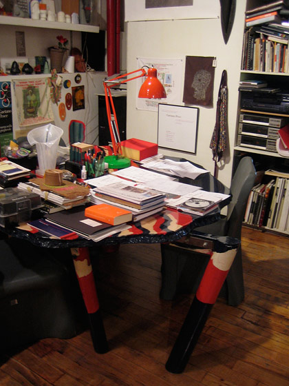 I tracked down Italian designer Gaetano Pesce in his studio, which was a feat since he travels so much. He's like the mad scientist of the design world, creating  fantastical pieces of furniture with unconventional materials: silicone, polyurethane, steel, and resin. He's in MoMA's permanent collection, and is sold at Moss. This is his desk. When the leg broke, he fixed it at this angle; he liked the way it looks.