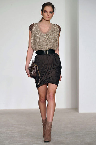 "<a href=""http://nymag.com/fashion/fashionshows/2009/fall/main/newyork/womenrunway/dereklam/"">Derek Lam's</a> belt cinches the waist and pulls the outfit together."