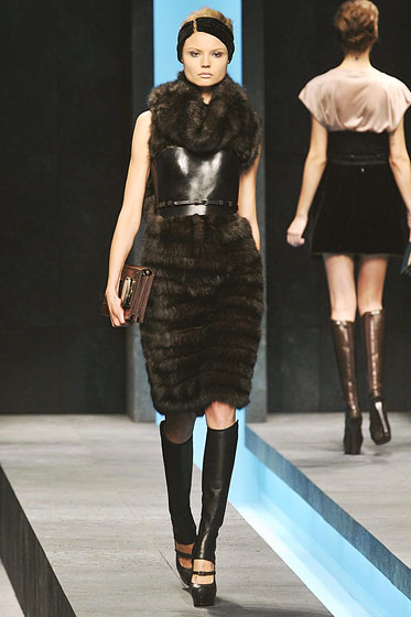 "<a href=""http://nymag.com/fashion/fashionshows/2009/fall/main/europe/womenrunway/fendi/"">Fendi's</a> corseted belt adds texture and a hint of bondage."