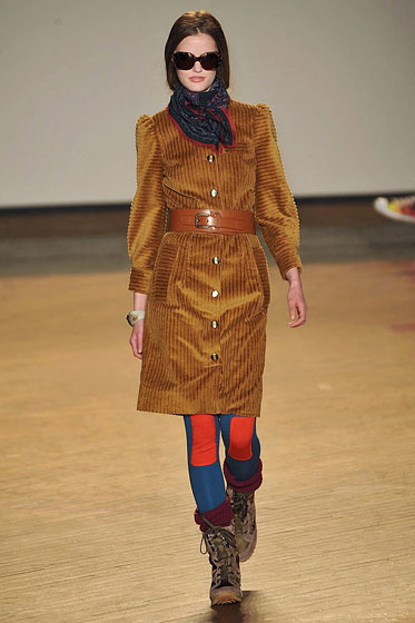 "<a href=""http://nymag.com/fashion/fashionshows/2009/fall/main/newyork/womenrunway/marcbymarcjacobs/"">Marc by Marc's</a> belt adds shape over a fall coat."