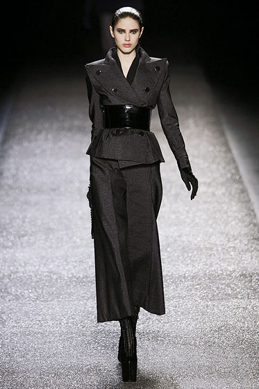 "<a href=""http://nymag.com/fashion/fashionshows/2009/fall/main/europe/womenrunway/ninaricci/"">Nina Ricci's</a> black patent leather gives a double-breasted blazer some extra shine."