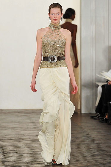 "A brown leather belt adds a country touch to an embellished gown at <a href=""http://nymag.com/fashion/fashionshows/2009/fall/main/newyork/womenrunway/ralphlauren/"">Ralph Lauren</a>."
