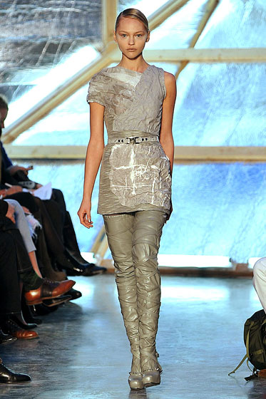 "<a href=""http://nymag.com/fashion/fashionshows/2009/fall/main/newyork/womenrunway/rodarte/"">Rodarte's</a> monochromatic tan gets some texture with leather straps on belts and boots."