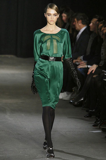 "A loose satin dress gets polished with a simple black belt at <a href=""http://nymag.com/fashion/fashionshows/2009/fall/main/newyork/womenrunway/thakoon/"">Thakoon</a>."