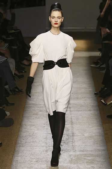 "A black belt cinches a flowy dress at <a href=""http://nymag.com/fashion/fashionshows/2009/fall/main/europe/womenrunway/yvessaintlaurent/"">YSL</a>."