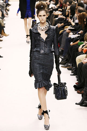 "Leather now comes in scrunchy skirt suits made by <a href=""http://nymag.com/fashion/fashionshows/2009/fall/main/europe/womenrunway/louisvuitton/"">Louis Vuitton</a>."