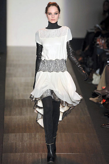 "<a href=""http://nymag.com/fashion/fashionshows/2009/fall/main/newyork/womenrunway/maxazria/"">Max Azria</a> toughened up a white, chiffon dress with thick leggings."