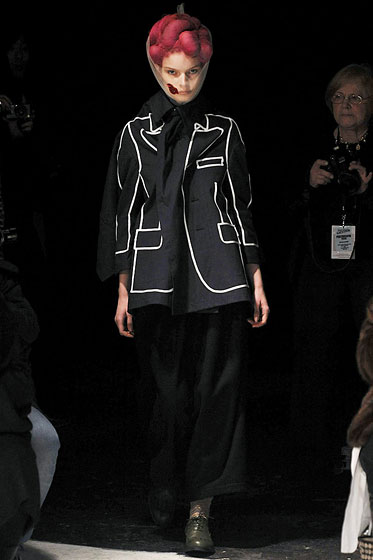 "<a href=""http://nymag.com/fashion/fashionshows/2009/fall/main/europe/womenrunway/commedesgarcons/"">Comme des Garcons'</a> avant-garde version has white piping."