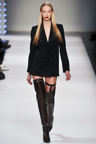 "<a href=""http://nymag.com/fashion/fashionshows/2009/fall/main/europe/womenrunway/husseinchalayan/"">Hussein Chalayan</a> makes a boxy blazer sexy by pairing it with just thigh-high boots."
