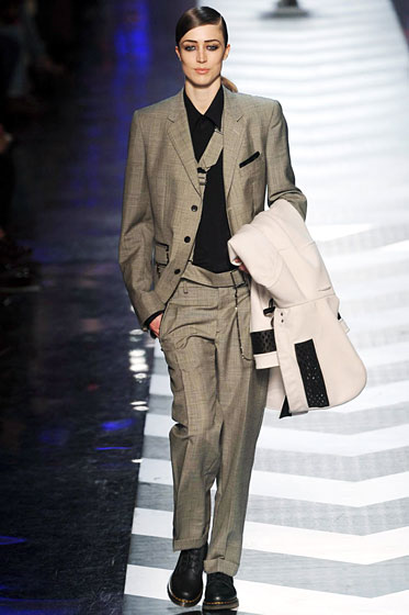 "An androgynous suit by <a href=""http://nymag.com/fashion/fashionshows/2009/fall/main/europe/womenrunway/jeanpaulgaultier/"">Jean Paul Gaultier</a>."