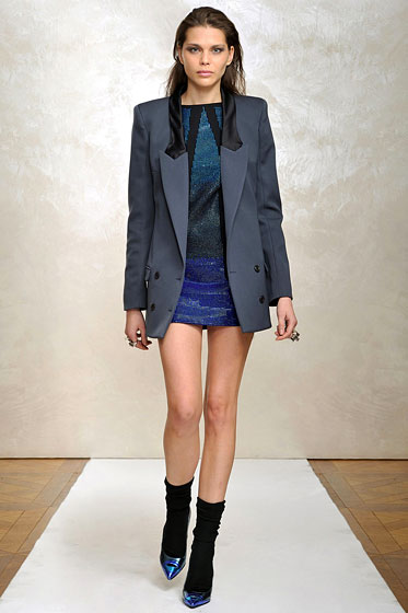 "An evening jacket with tuxedo touches pairs perfectly with a minidress at <a href=""http://nymag.com/fashion/fashionshows/2009/fall/main/europe/womenrunway/justcavalli/"">Just Cavalli</a>."