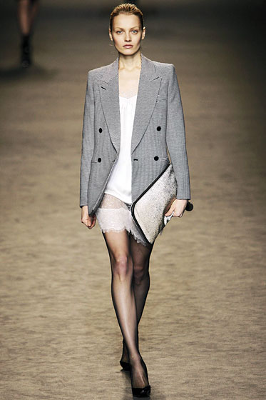 "<a href=""http://nymag.com/fashion/fashionshows/2009/fall/main/europe/womenrunway/stellamccartney/"">Stella</a> sent a gray blazer out over a white mini with sheer trim. Masculine meets feminine."