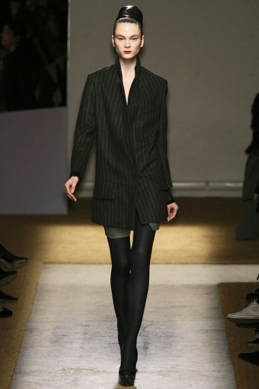 "<a href=""http://nymag.com/fashion/fashionshows/2009/fall/main/europe/womenrunway/yvessaintlaurent/"">YSL's</a> chic, chalk-striped coat."