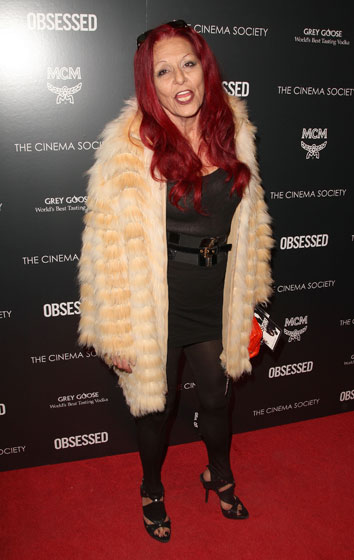 Bless Pat Field for wearing a corset dress, that hair color, a fur coat, and stirrup pants all at the same time. We love that woman.